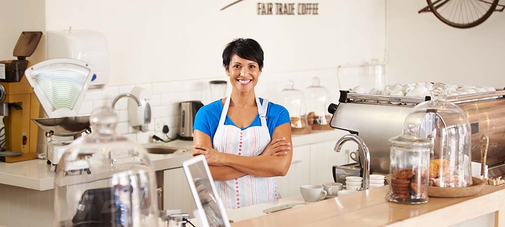 Coffeeshop owner enjoying the benefits of a business loan